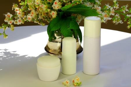 Chestnut tree flowers, a jar of cream, a milk and a shampoo