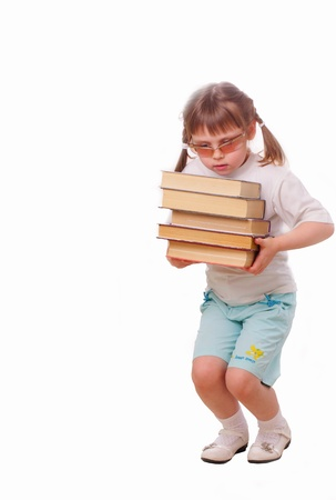 Little girl in sun glasses carries a stack of books photo