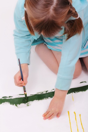 sincere girl: Little girl paints a nice picture Stock Photo