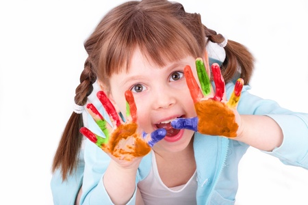 Little girl plays with her colored hands