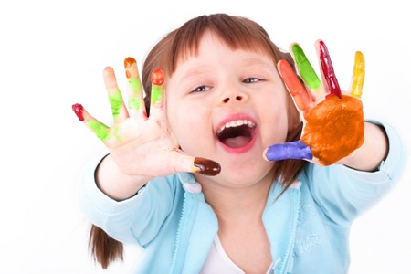 by feel: Little girl shows her colored hands