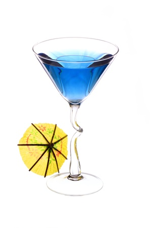 Wineglass are filled with blue beverage and cocktail umbrella