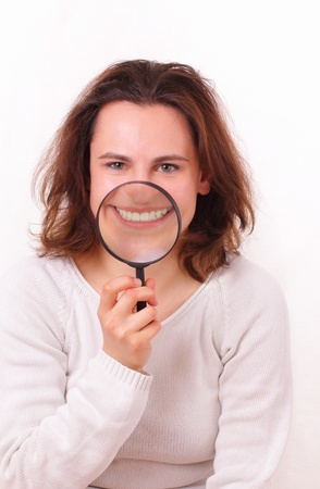Beautiful and funny young girl shows her white teeth Stock Photo - 13428206