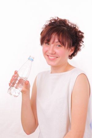 Funny young girl with a bottle of mineral water Stock Photo - 13428198