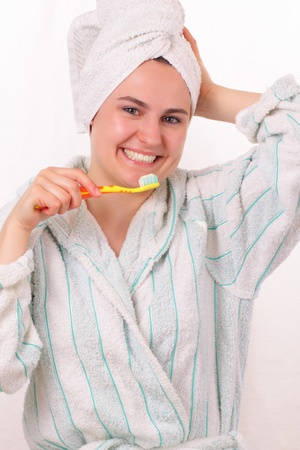 Happy young girl brushes her teeth Stock Photo - 13428208