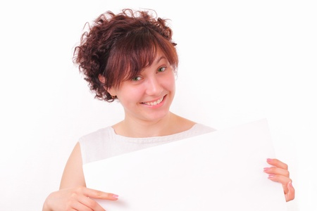 Pretty young girl with a blank sheet of paper