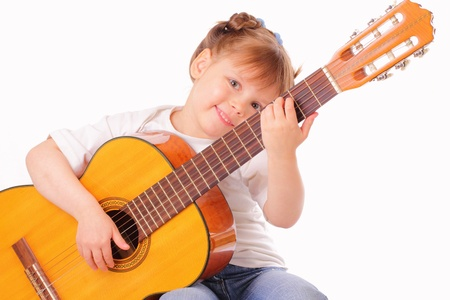 Funny little girl plays guitar photo