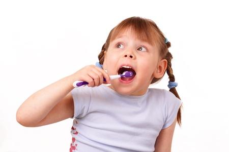 Pretty little girl brushes her teeth Stock Photo - 13776302