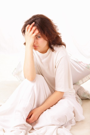 sick young woman sitting in bed Stock fotó