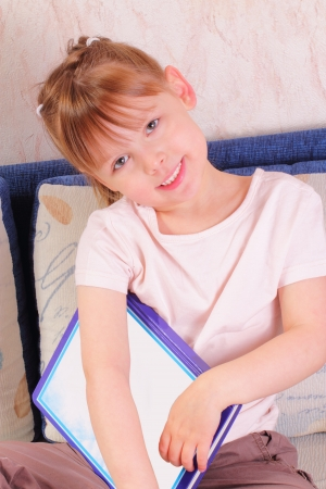 Beautiful little girl with book photo