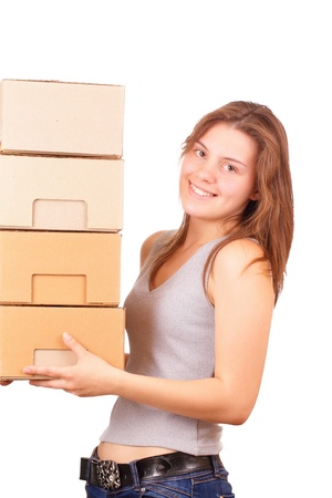 Beautiful young girl moving into a new house Stock Photo