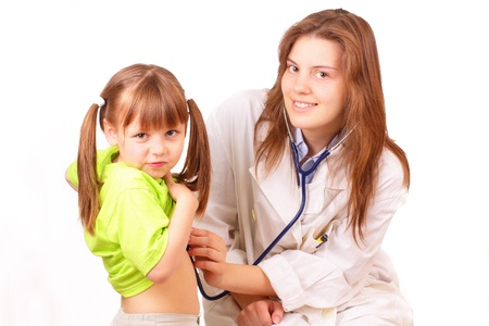 Medical doctor woman inspects beautiful little girl Stock Photo - 14163163