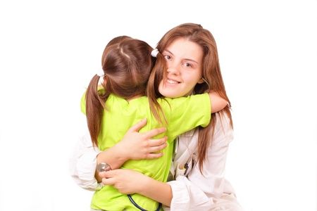 Young medical doctor woman with little girl photo
