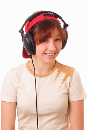 Funny young girl litening to music with headphones