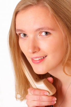 Pretty young woman talking on the old phone Stock Photo - 14446815