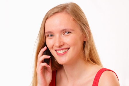 Smiling young girl talking on the mobile phone photo