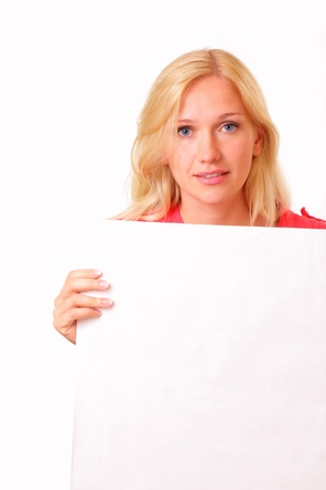Beautiful young woman with a sheet of paper