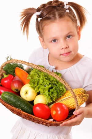 Pretty little girl with vegetables and fruits