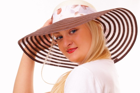 Attractive blonde woman in a hat Stock Photo - 15891399