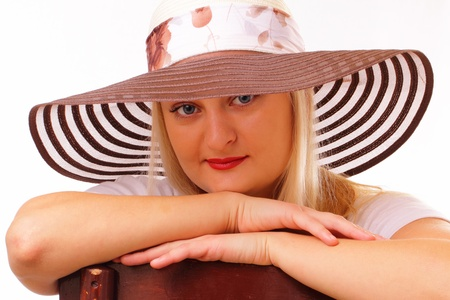 Beautiful blonde lady in a hat photo