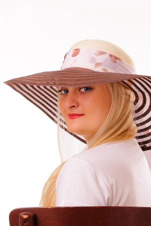 Charming blonde lady in a hat Stock Photo