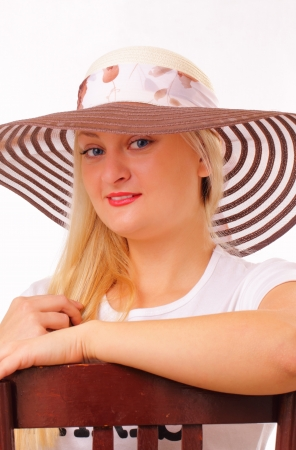 Happy blonde woman in a hat Stock Photo - 15891394
