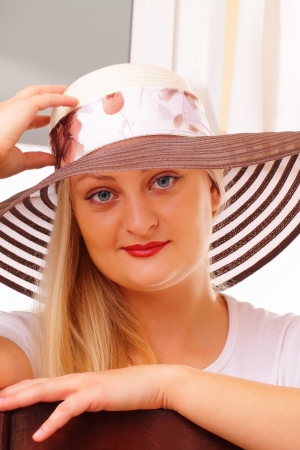 Pretty blonde lady in a hat Stock Photo - 15891400