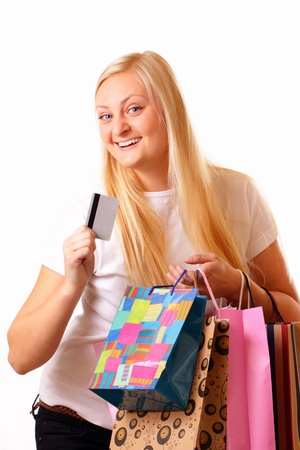 Happy blonde woman with purchases and discount card
