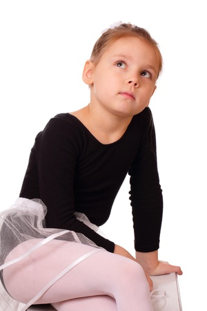 Thoughtful little ballerina girl photo