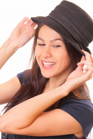 Attractive young brunette woman in a hat Stock Photo - 16405552