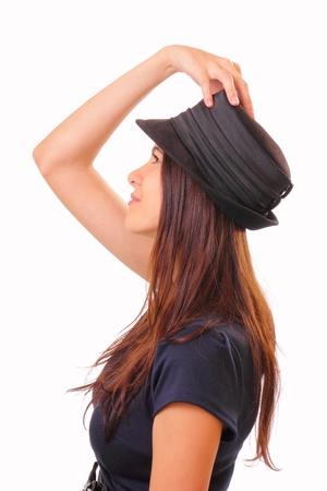 Beautiful brunette woman in a hat Stock Photo - 16405548