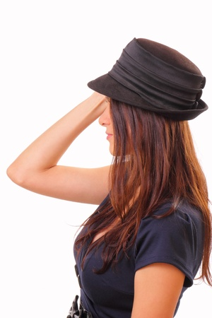 Pretty young brunette woman in a hat
