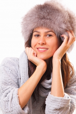 Attractive brunette woman in a fur hat Stock Photo - 16495002