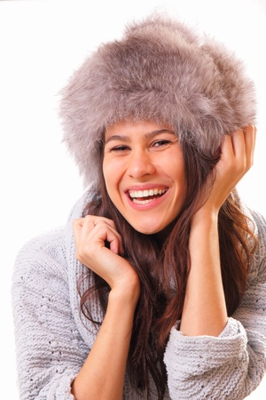 Funny brunette woman in a fur hat Stock Photo - 16495056