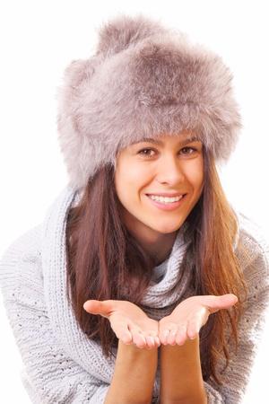 Smiling brunette woman in a fur hat