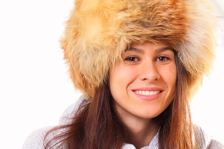 Young brunette woman in a fur hat photo
