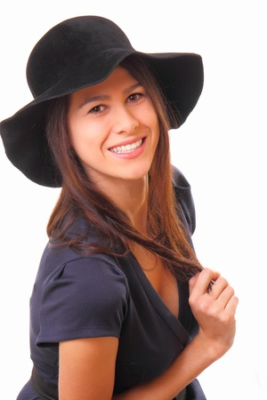 Attractive and happy young woman in a black hat Stock Photo - 16824449