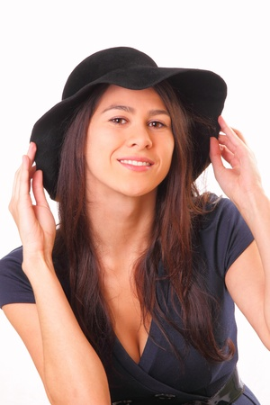 Attractive woman in a black hat Banque d'images