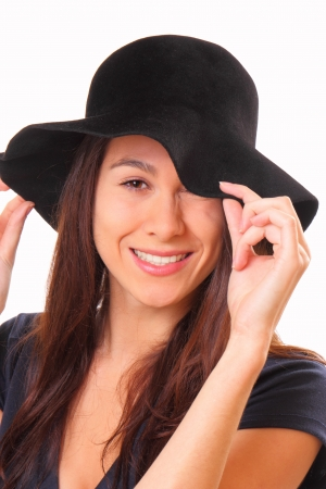Attractive young woman in a black hat