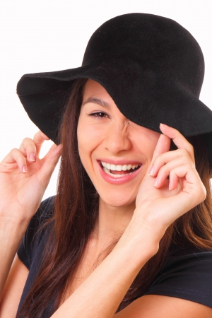 Charming and happy young woman in a black hat Banque d'images