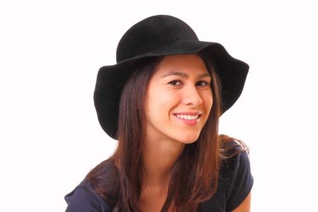 Pretty and smiling young woman in a black hat Stock Photo