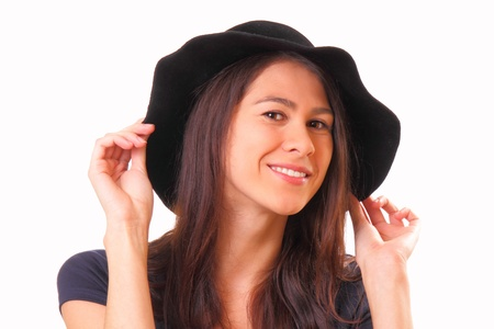 Pretty young woman in a black hat photo