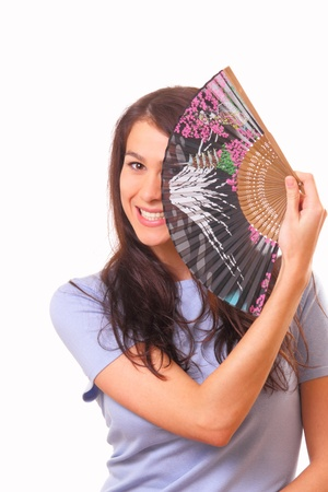 Pretty young woman with a fan