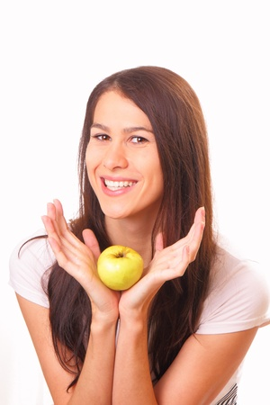 Pretty young woman with an apple photo