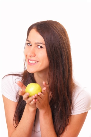 Beautiful and happy young woman with an apple photo