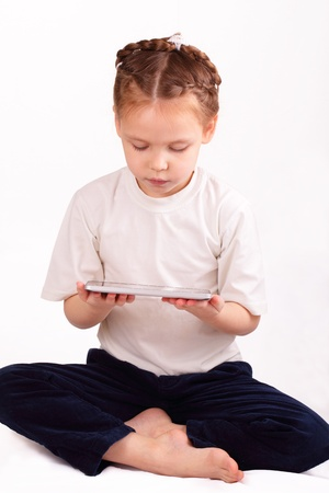 Beautiful little girl with modern ipad Stock Photo