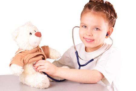 Smiling little doctor girl Stock Photo