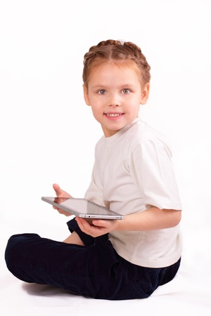 Smiling little girl with ipad