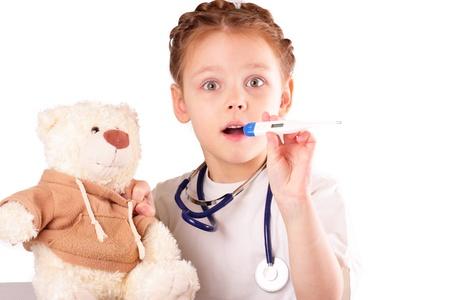 Surprised little doctor girl photo