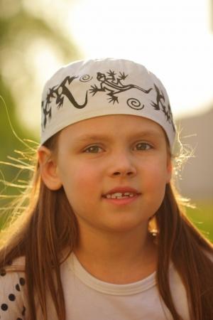 Beautiful little girl outdoors Stock Photo